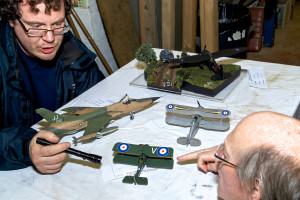 Judges Rory Cook and Rob Millinship inspect the entrants in Category 2 of the scale model competition